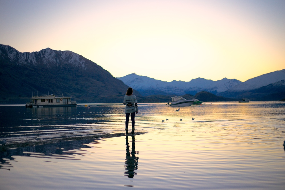 Standing on water in Lake Wanaka at sunset.
