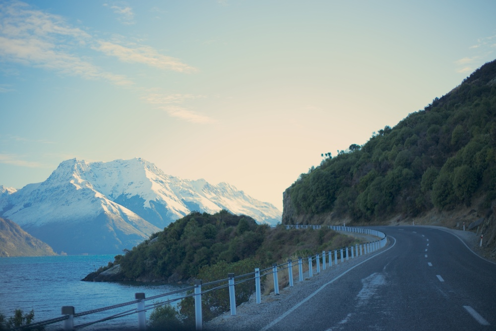 Driving NZ roads to Wanaka - mountains on either side.