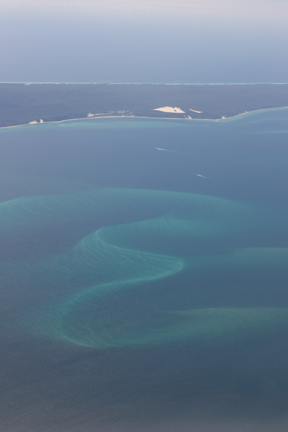 Turquoise patterns made by currents in the sea.