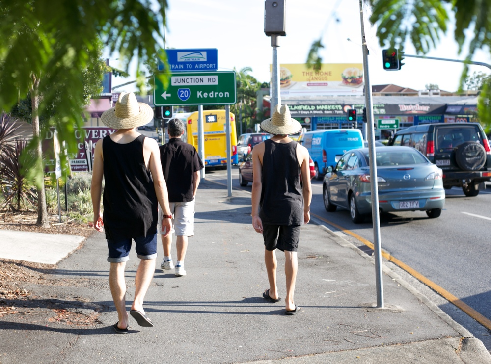 Dannin and Oliver look alike in Australia - hats and singlets.