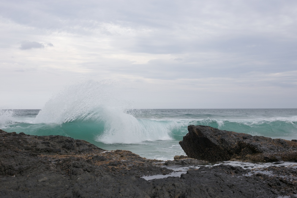 A turquoise wave breaking at surfers paradise, Australia.