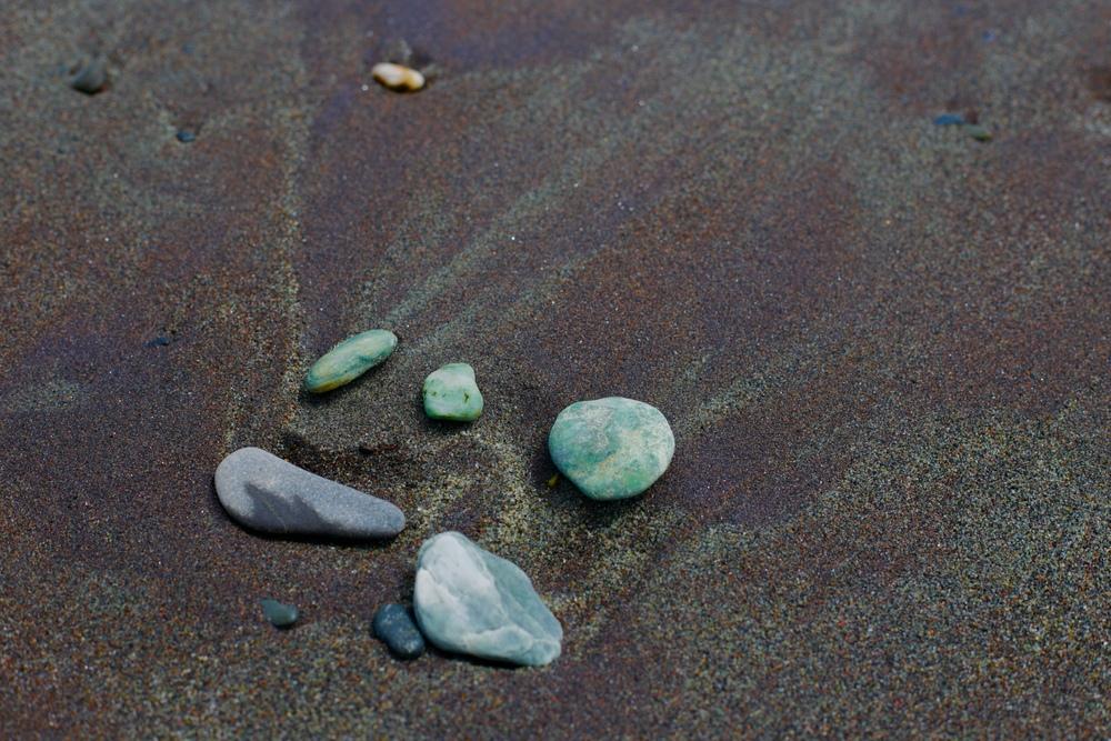 Small bits of greenstone on the beach in Hokitika.