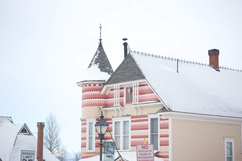 Snow on a pink house in Leadville, Colorado.
