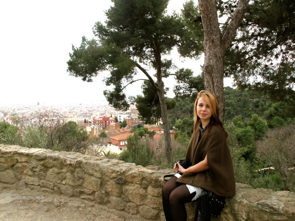 Rita sitting on a fence in Parc Güell, Barcelona