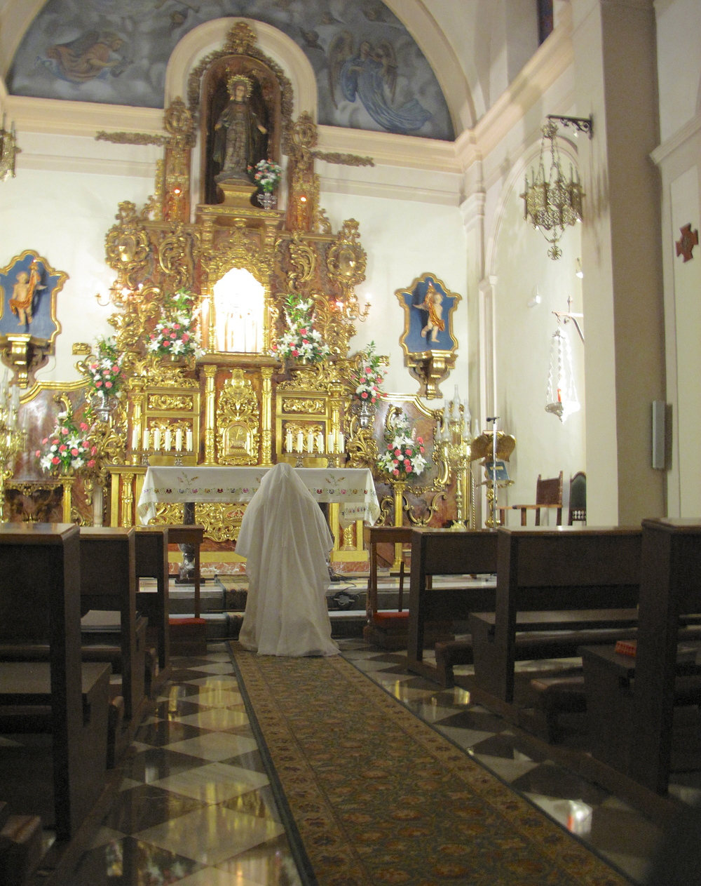 Nun praying at a chapel in Granada, where prayers are said round the clock.