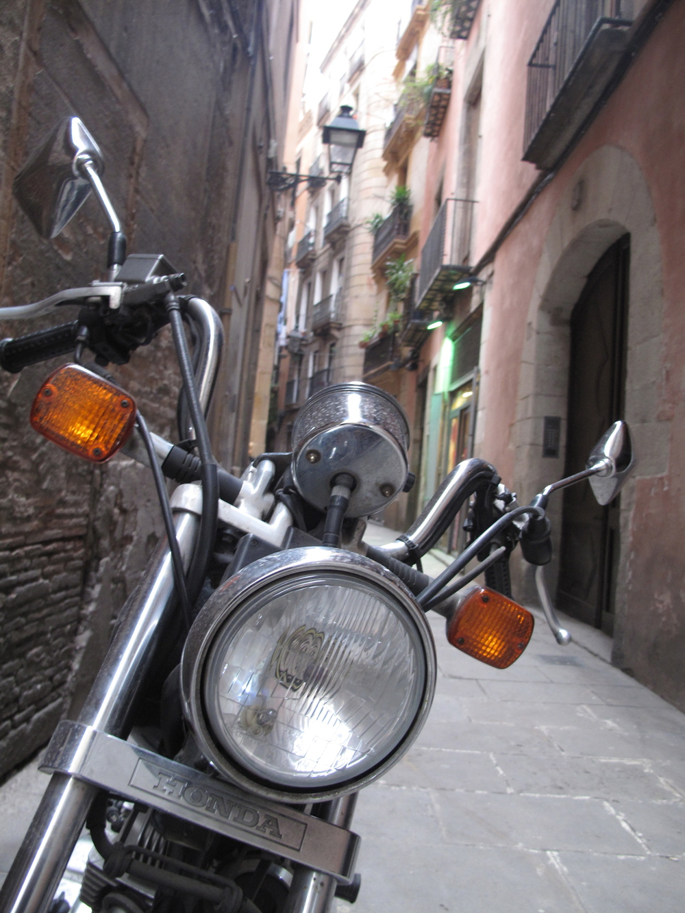 Scooter headlamp, Barcelona alleyway.