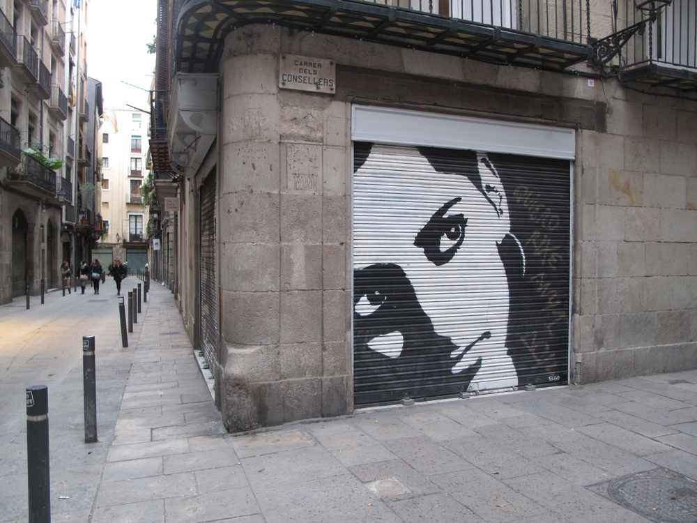 Barcelona street art - painting of a woman.