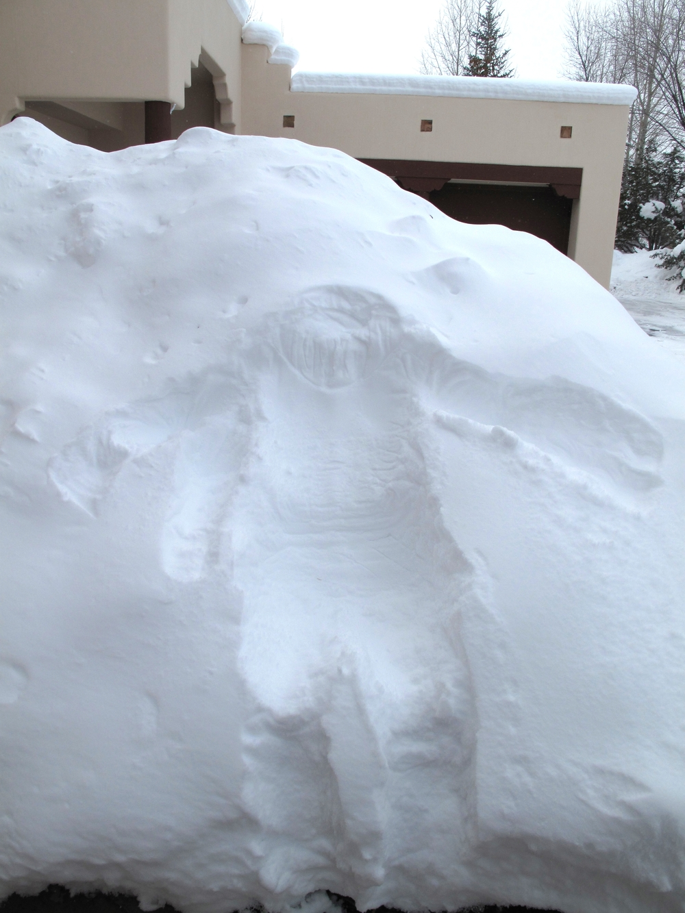 Body shape in a snow bank. Snow angels.