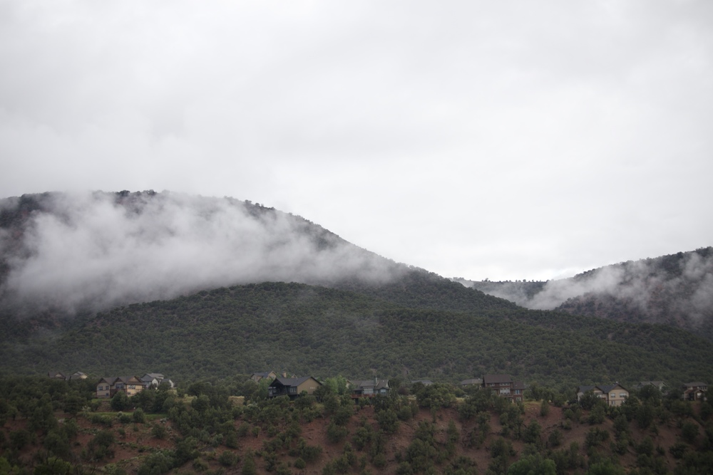 Low hanging clouds over hills.