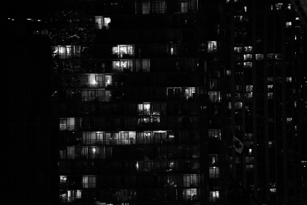 Windows of the city all lit up at night.
