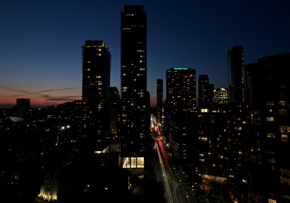 Sunset over Toronto cityscape.