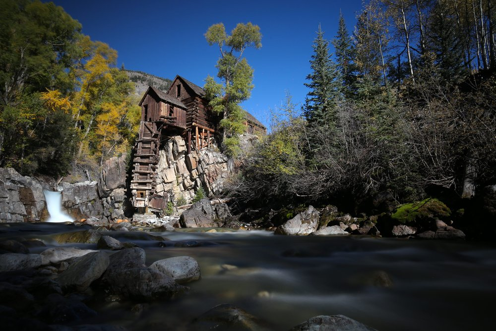 The Crystal Mill in Fall, rushing waterfall and river.