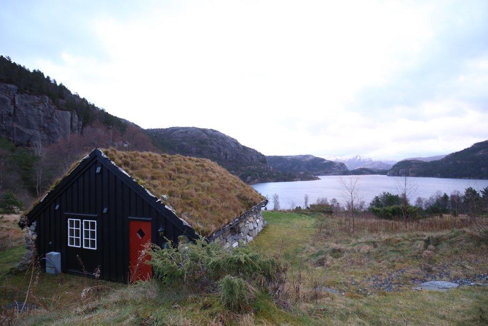 turf house by lake