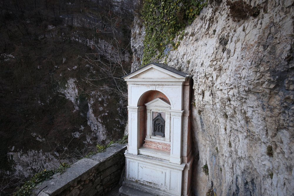 Small pink shrine on the cliffside.