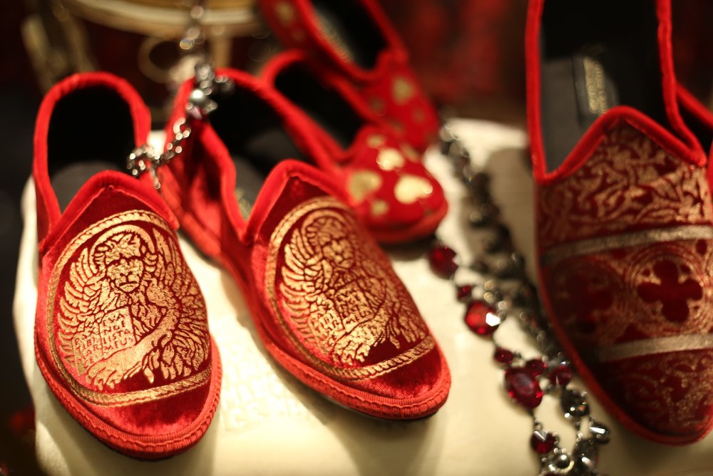 Window shopping in Venice - I spy luxurious red slippers gilt with gold.