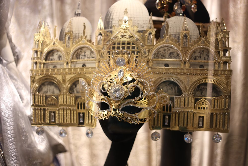 Gold glittery carnival mask in the form of St Mark's Basilica.