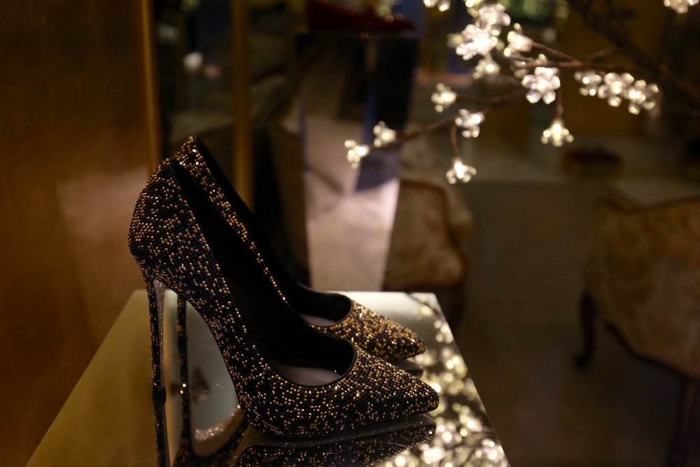 Gold shoes sparkling in a window.