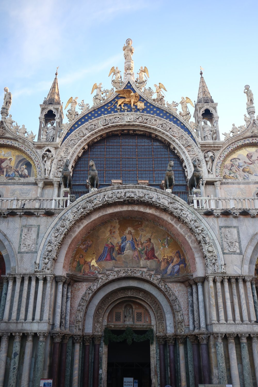 The façade of St Mark's Basilica - all rose and gold and lions and stars.