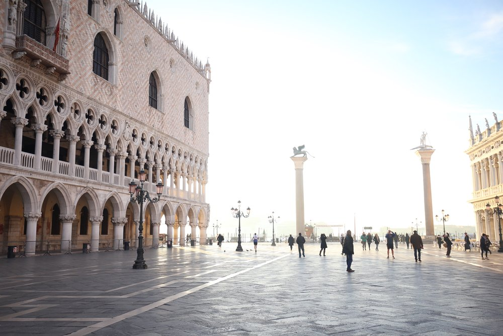The pink stone façade of the Doge's Palace in the Palazzo Ducale.