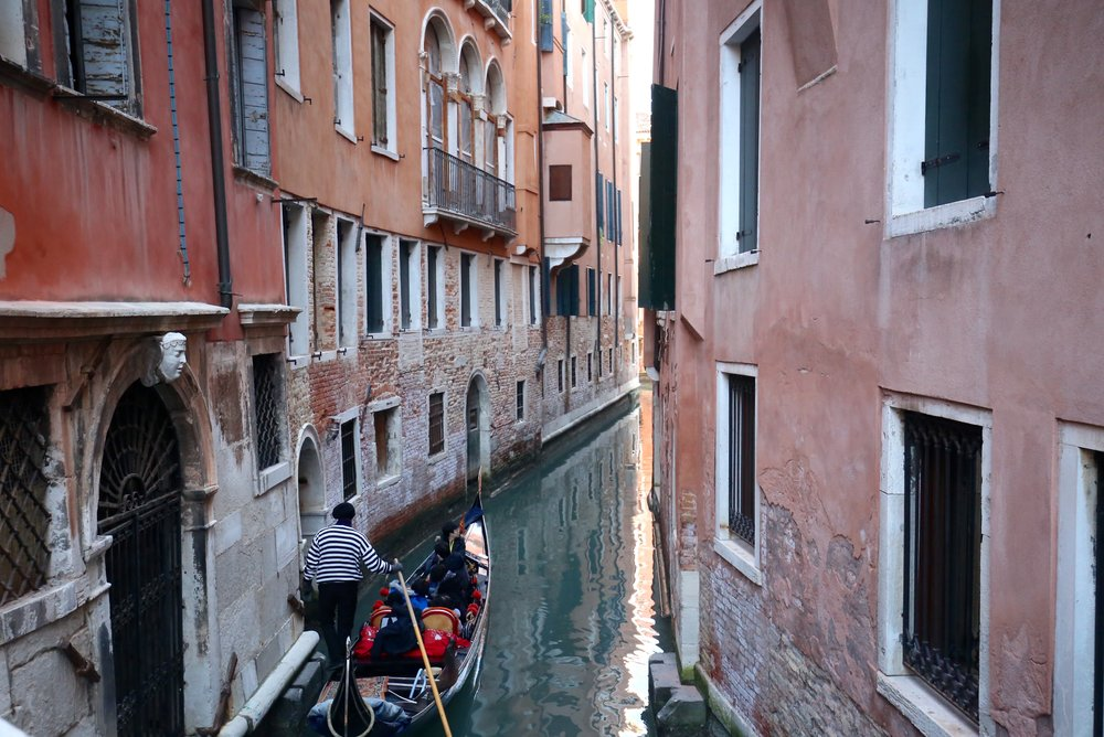 The gondolier of Venice sings as he boats his passengers on blue canals.