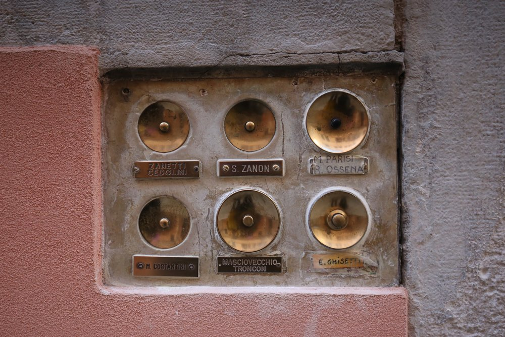 Old gold doorbells in Venice.