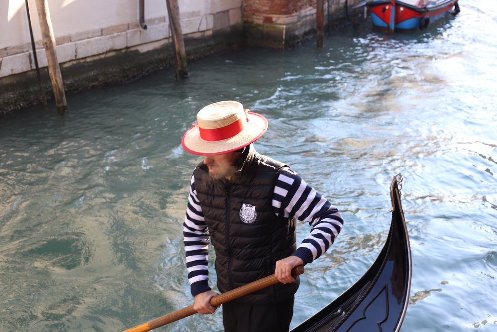 The gondolier sings and his breath forms clouds on a cold morning in Venice.