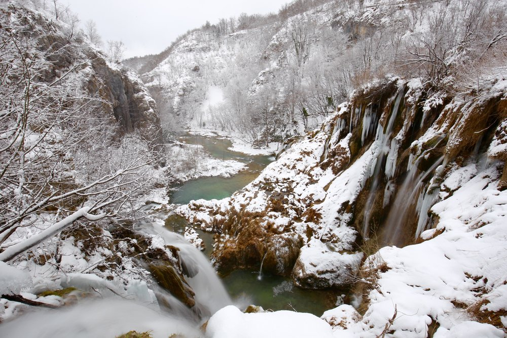 Waterfalls in Plitvice parks during winter - the waters are still blue.