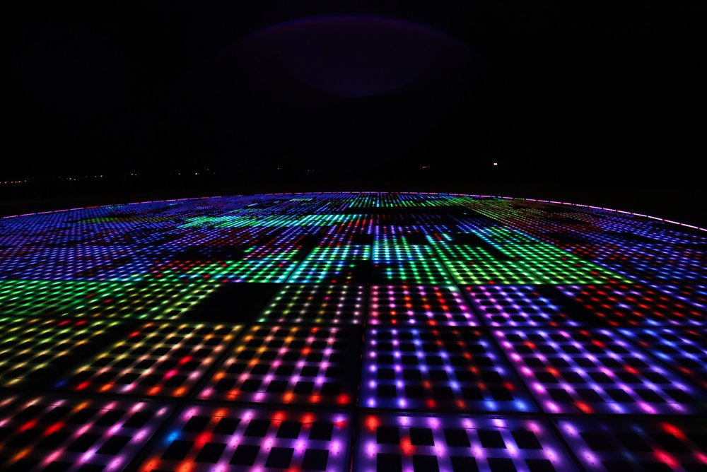 Colourful light installation - the floor lights up at night with moving colours.