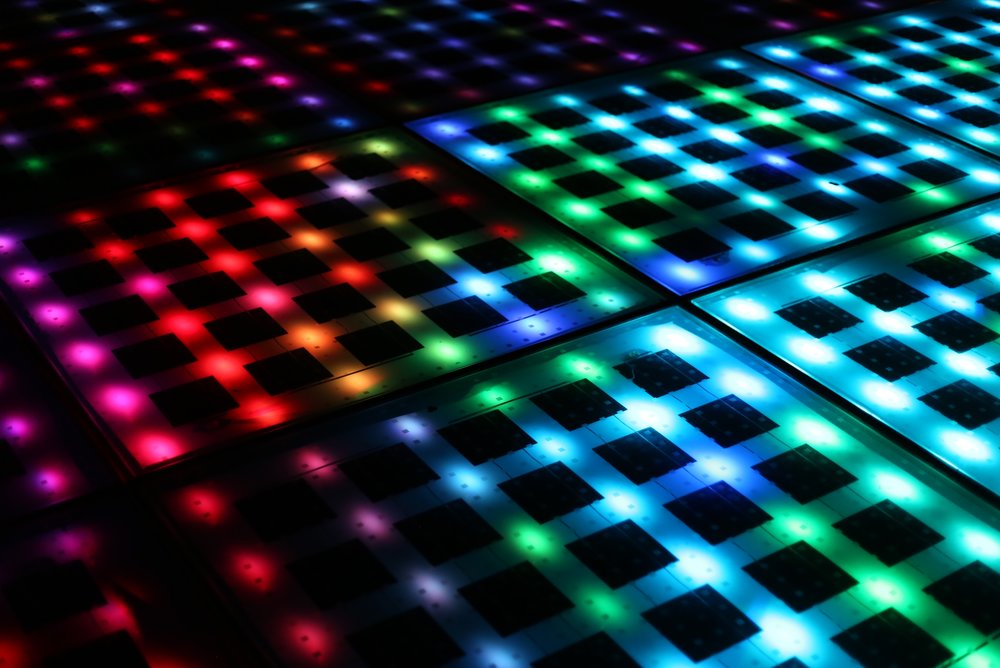 LED disco floor lit up at night.