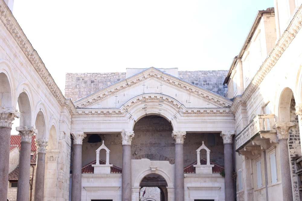 The marble pillars and white stone arches of Diocletian's Palace.