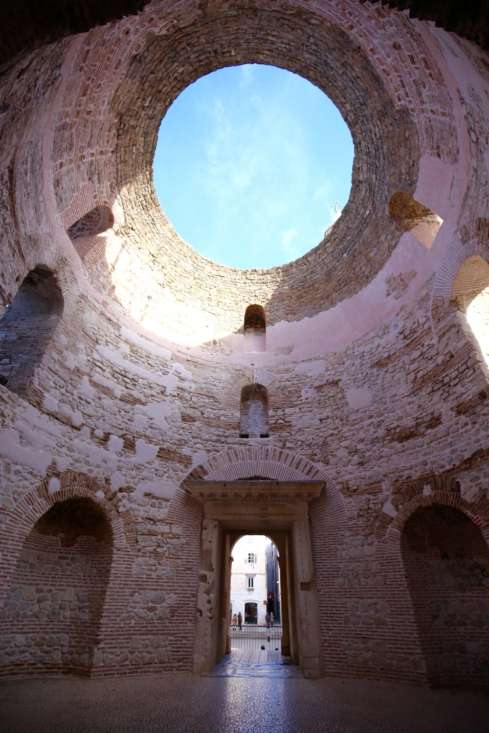 Diocletian's Palace in Split. The temple has a circular hole in the pink stone ceiling.