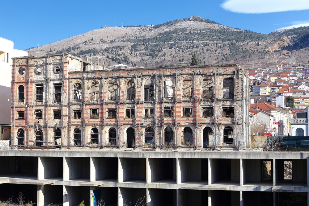 Ruins from the war - a building turned into a shell, Hercegovina.