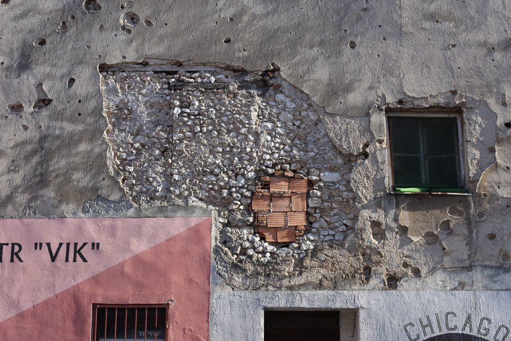 Bullet holes in a wall, Bosnia and Hercegovina.