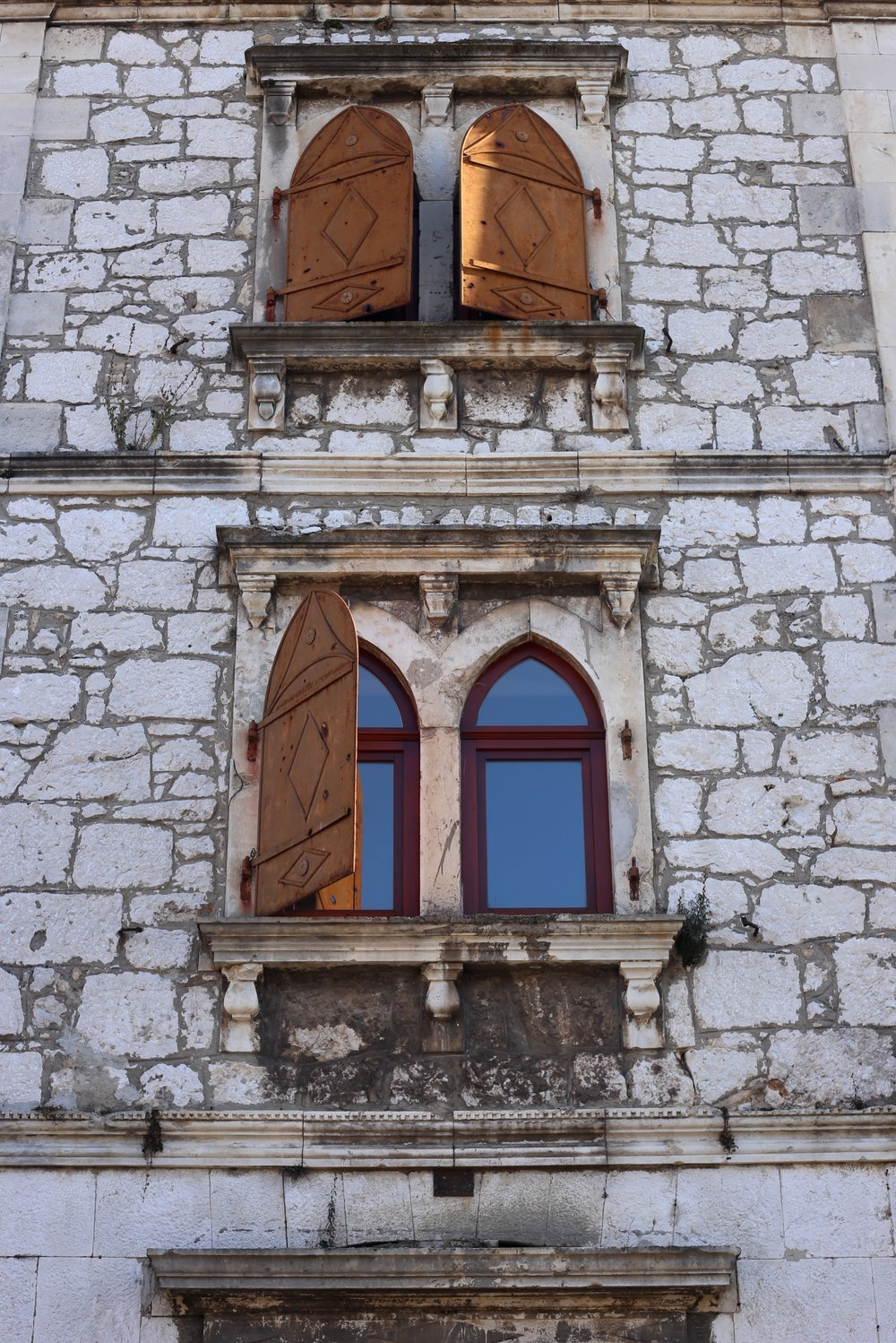 Moorish shuttered windows.