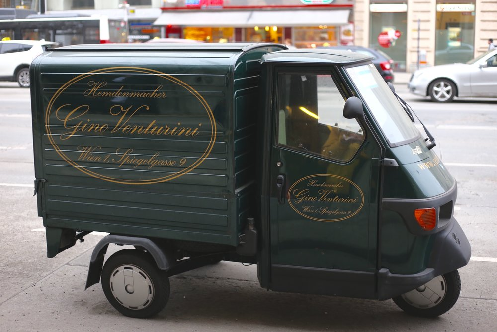 The real Grand Budapest - a tiny delivery van with gold lettering on the side.