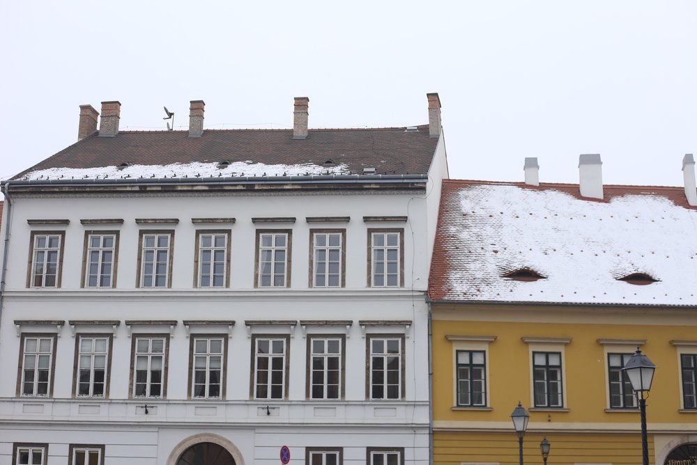 Small townhouses with snow on the roofs, in Budapest.