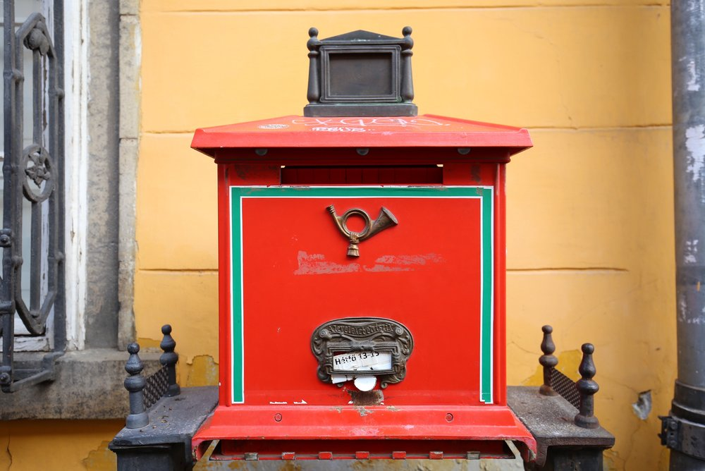 A splendid red post box with brass fittings, Budapest.