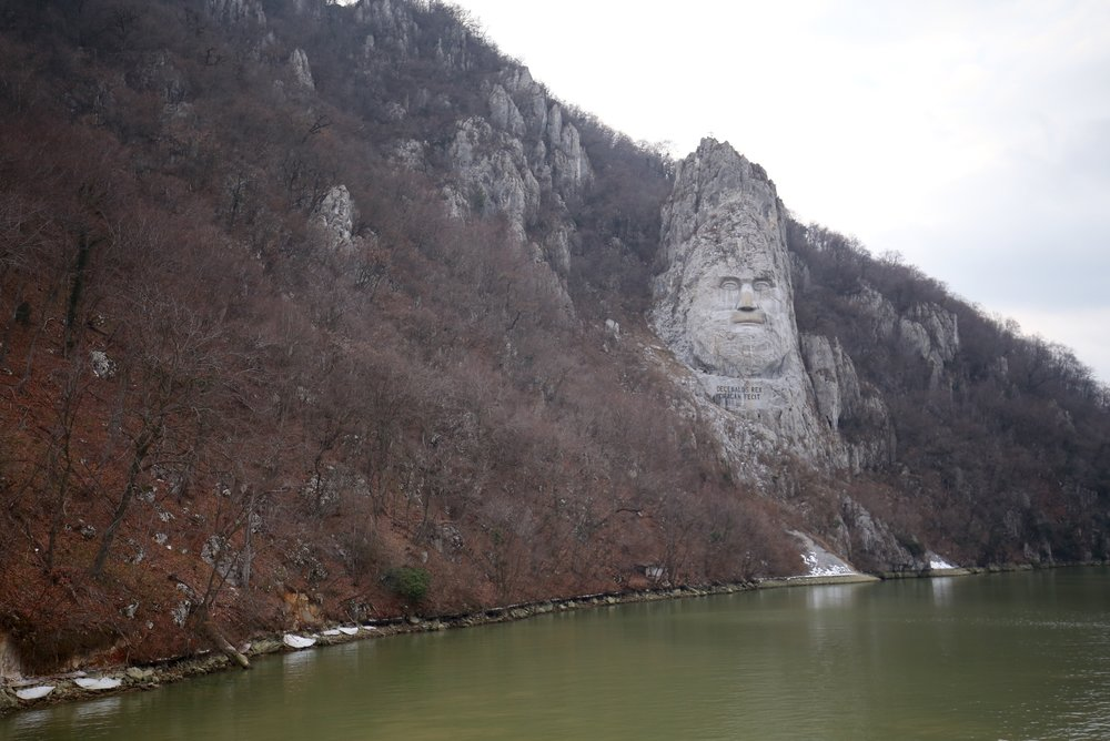 Decebal's head carved into a rockface.