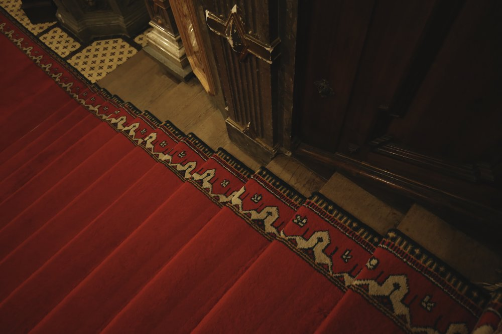 Red carpets on old creaky floors in Peles Castle.