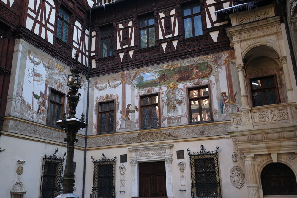 The painted courtyard of Peles Castle - a beautiful example of Romanian wooden architecture.