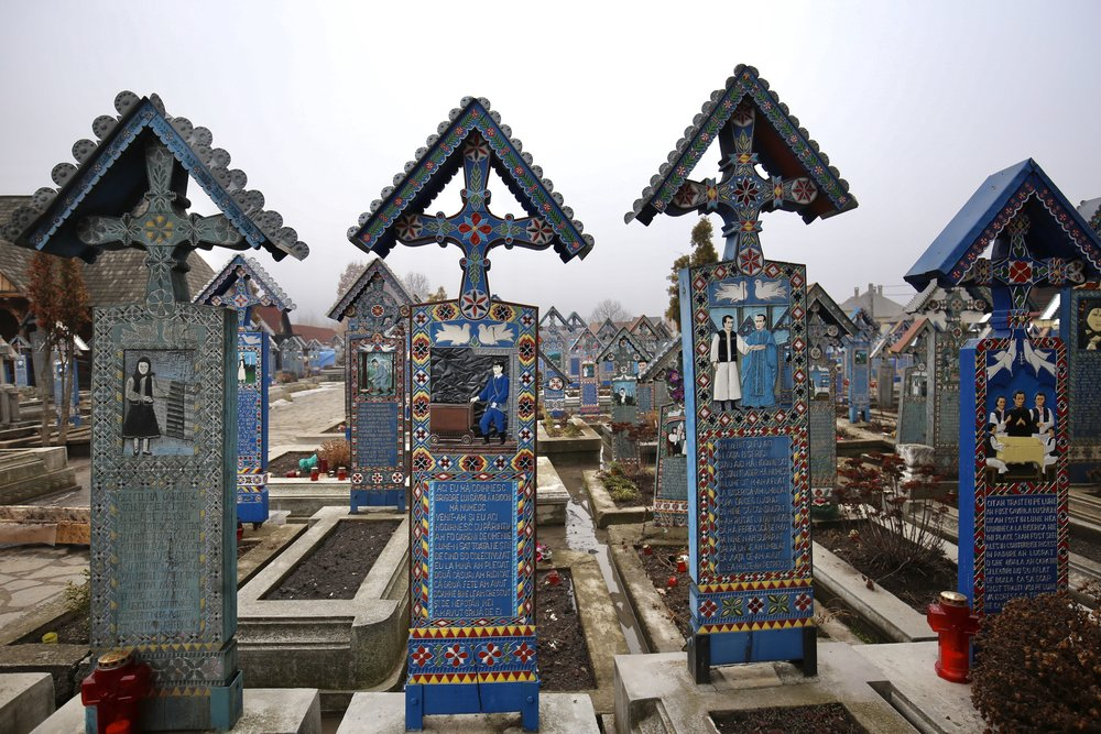 The Sapanta Merry Cemetery of Romania - where the grave markers are colourful.