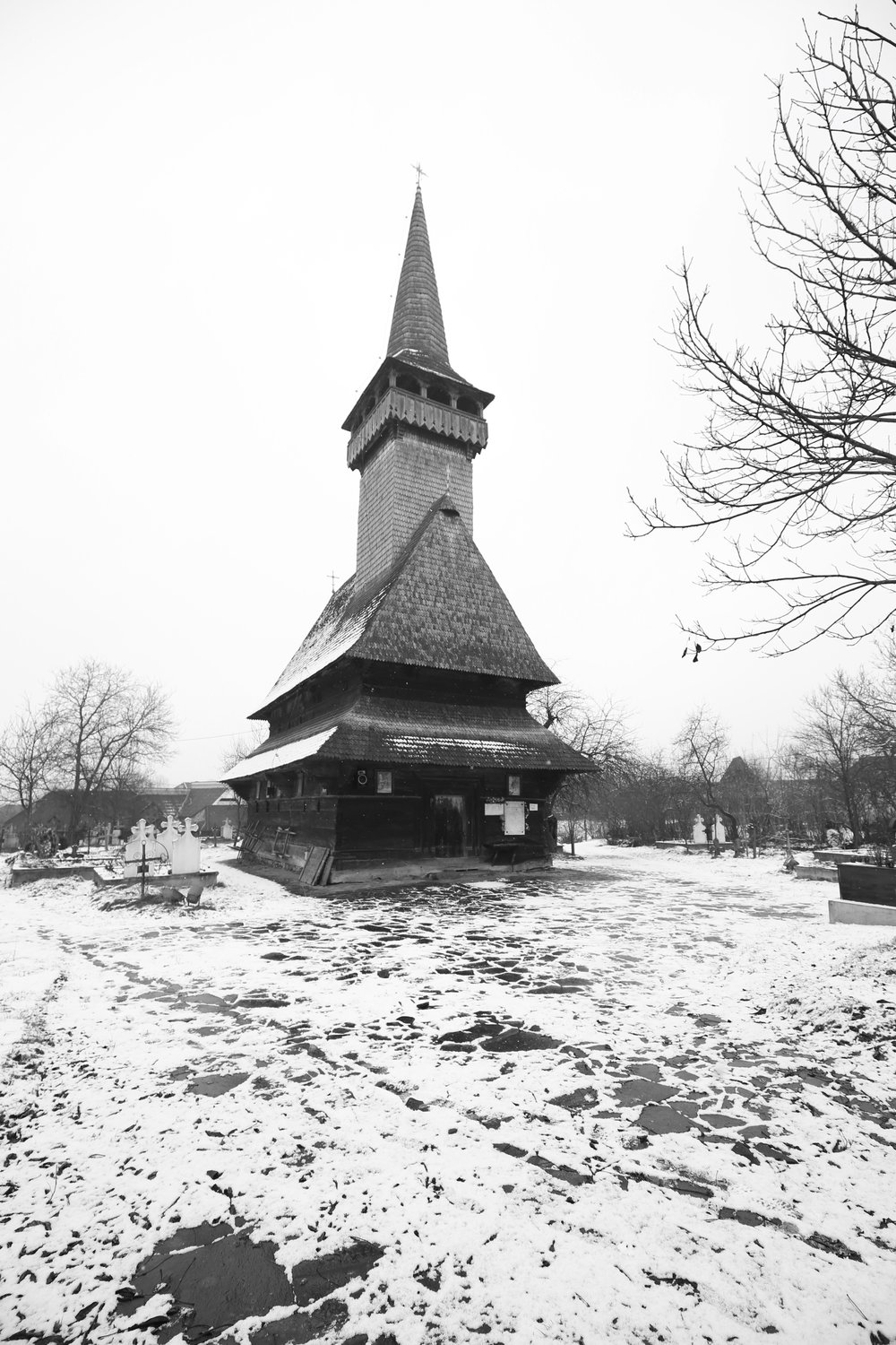 Wooden churches in Maramures with very tall steeples.