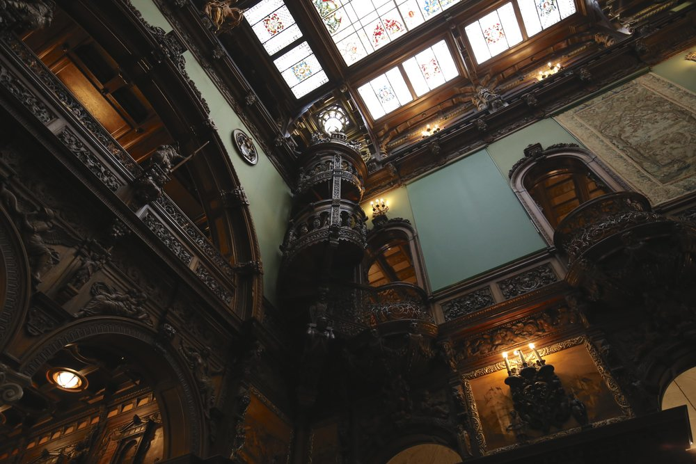 The spectacular wooden craftsmanship at Peles Castle - with spiral stairs and wooden walls.