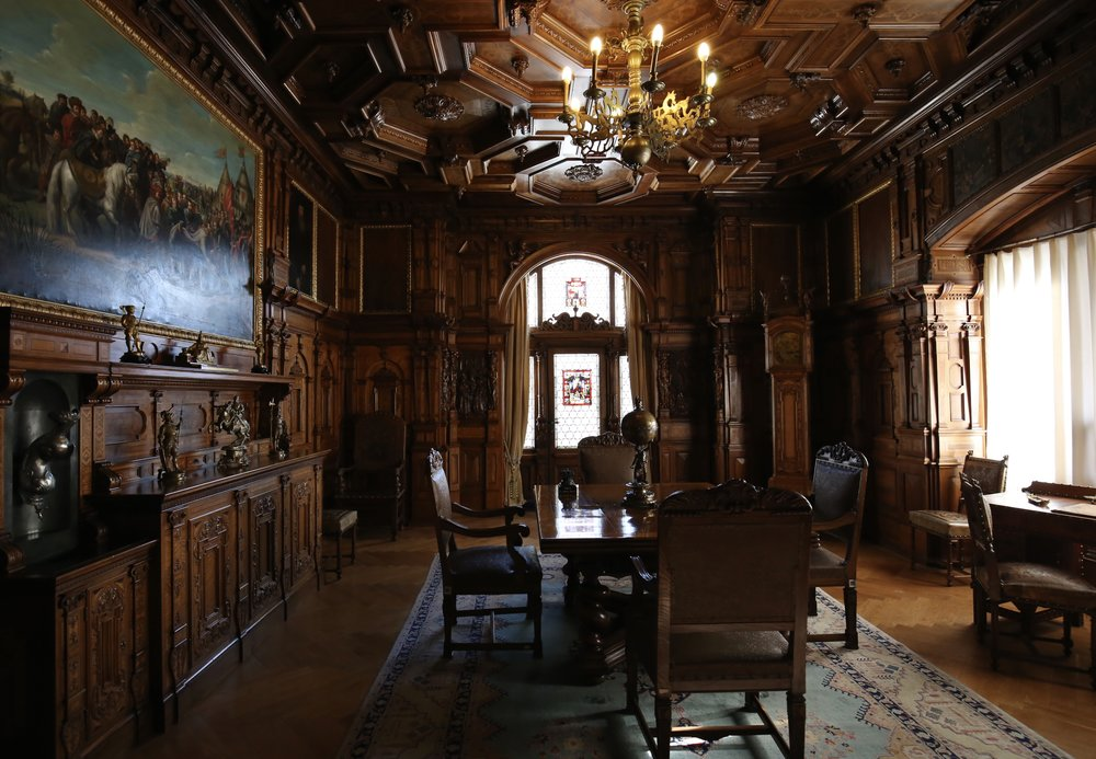 The beautiful woodwork of Peles Castle, in a grand map room.