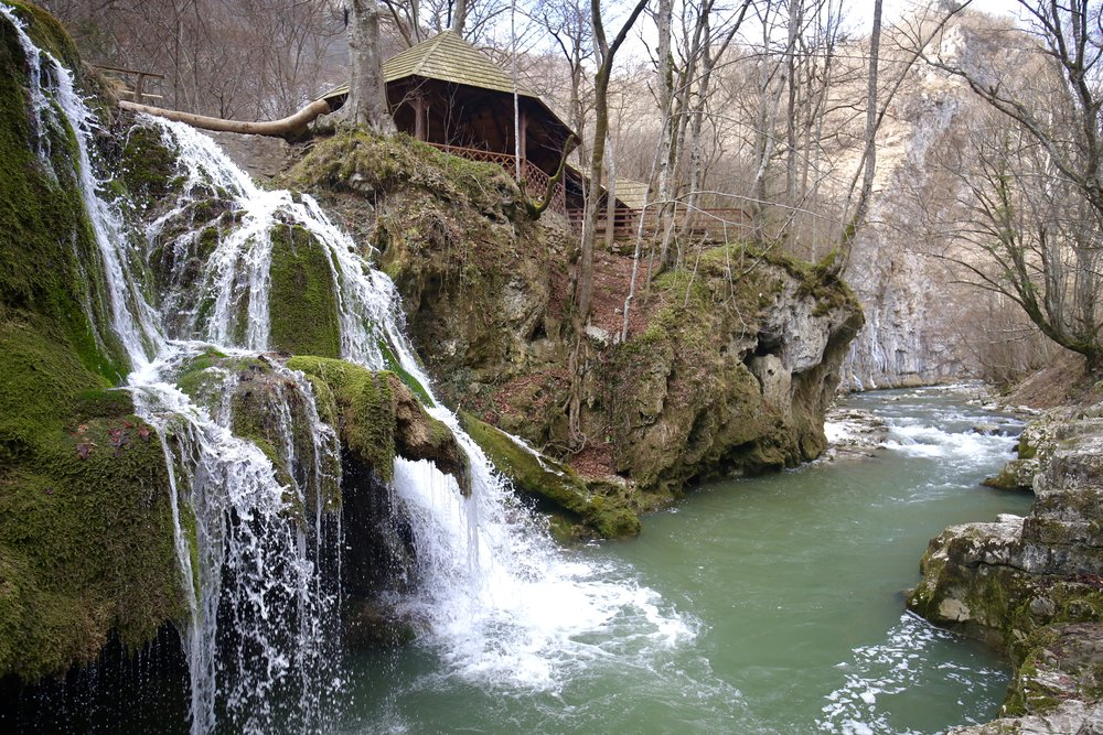 Bigar Cascades - the mossy waterfall of Romania, below a small pagoda.