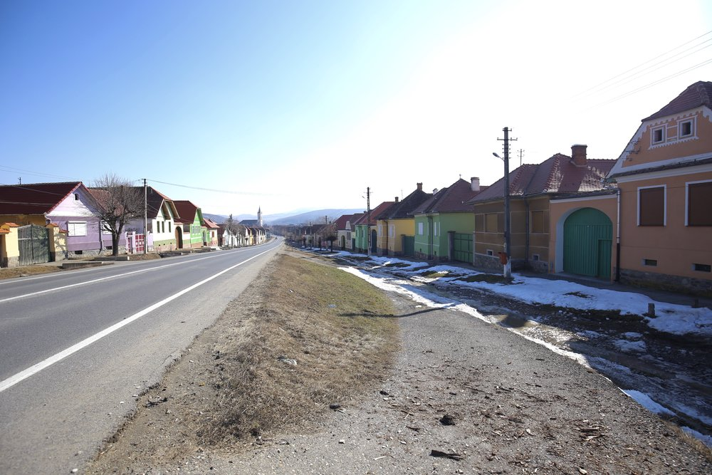 A colourful little Romanian village with pastel painted houses.