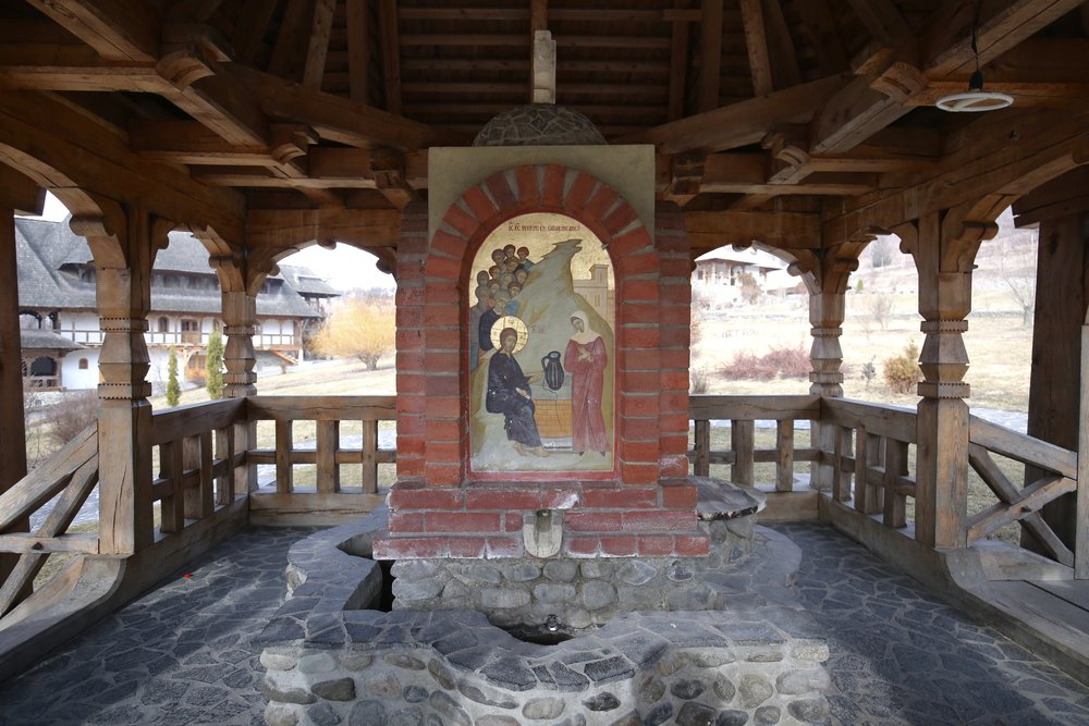 A small shrine over a spring, inside a Romanian monastery.