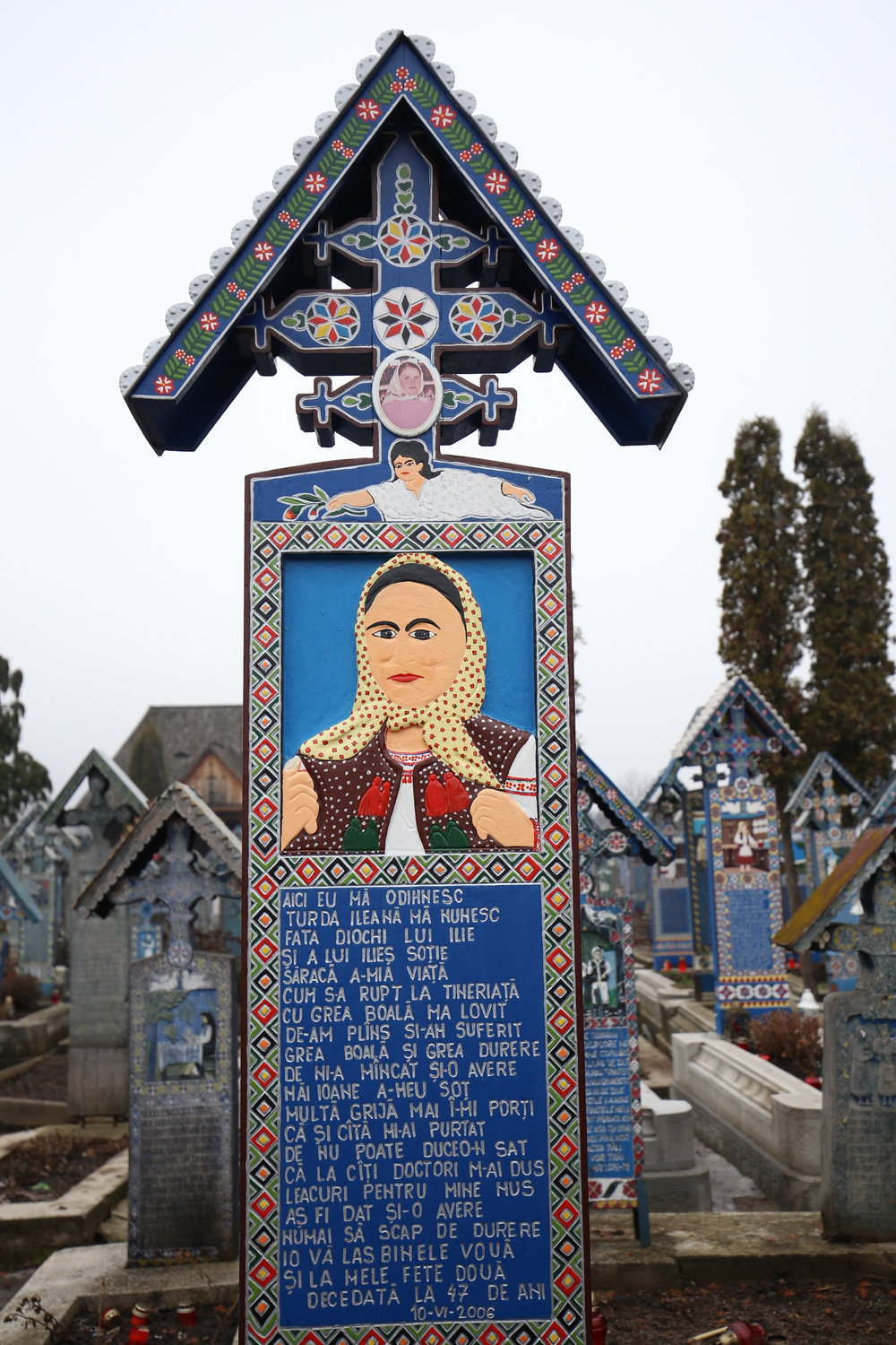 A colourful grave marker in the Merry Cemetery of Sapanta - with a Frida Kahlo esque portrait.