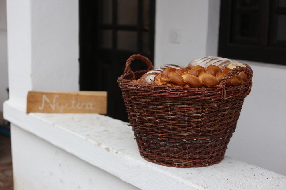 Bread in a basket outside the baker's shop - Holloko.