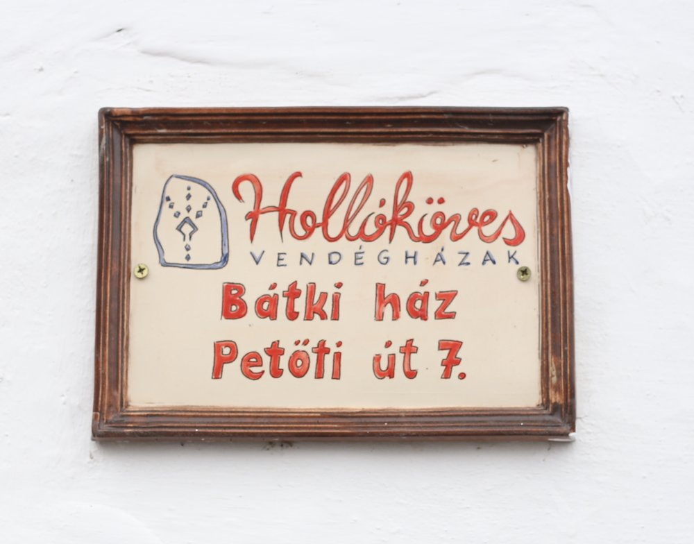 Small shop sign in Hungarian.